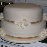 122325747938736.jpg 50th wedding anniversary cake. Carrot cake with ivory fondant, roses and leaves are half fondant and half gumpaste, it was so HEAVY! I&#039...