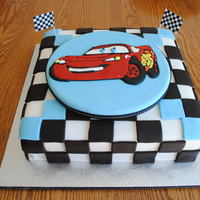 Lightning Mcqueen My grandson's 3rd b-day cake. Lightning McQueen - first time making a colour flow plaque.