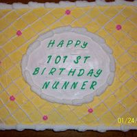 101St Birthday Cake this is a white chocolate flavored cake with buttercream icing. the icing is a pale yellow with white lattice work and pink flowers. the...