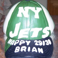 New York Jets Baseball Cap This is a Jets baseball cap. It's a yellow cake with BC frosting covered in fondant.