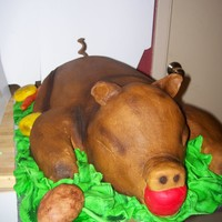 Fred The Pig cake iced in buttercream and airbrushed details - all vegetables and apple are fondant