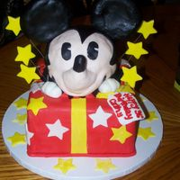 Mickey Mouse For You was asked to re-create a picture the client found on the internet. made a couple of variations. Mickey is rct covered with mmf and cake is...