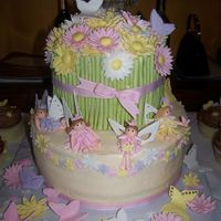 Fairies And Flowers  this was a carrot cake iced with decorators cream cheese iceing(recipe on CC) and it was soooo good!!! fairies flowers and butter flies...