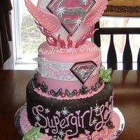 Supergirl!!!  This was for my Daughters 6th B-day. I went overboard but she loved it! SO much fun. The topper is gumpaste and hardened fondant....