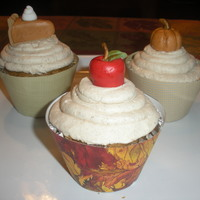 Fall Cupcakes   Pumpkin Pie Cupcakes with pumpkin spice buttercream. Decorated with fall decorations made from fondant.