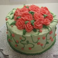 Rose Garden Cake Garden Themed Cake, with roses on top and vines and flowers coming off the sides