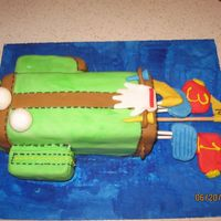 It's Tee-Off Tiem Golf Bag Cake   Pound cake made with buttercream frosting rolled in fondant