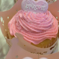 Princess Cupcakes These were so fun & easy to make and they were a great hit!Got the Princess wraps at Hobby Lobby and the candy toppers at a cake shop...