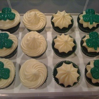 St. Pats Cupcakes Green velvet with candy melt shamrocks.