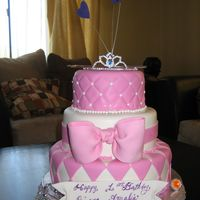 Princess Tiara Cake This cake was done for a little girls 1st birthday party. The top tier was her smash cake.