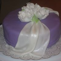 White Drape And Roses  made this for my final wilton gumpaste/fondant class. fun! butter cake with buttercream filling. MMF drape, covering and gumpaste flowers....