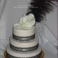 "Ostrich Feather And Lace Orchid Wedding Cake  6"",8""&10"" Stacked Wedding Cake. The bride had 40 x guests but still desired a large cake so the two top teirs are '..."
