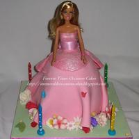 Barbie Cake  Cake is Orange and Chocolate Mudcake baked using a Dolly Varden Tin. Covered in Pink dyed Plastic Icing/Fondant. The doll's Corset has...