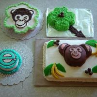Little E's First Birthday Cake Extravaganza  I had read about so many great ideas here I kinda went overboard and ended up making 4 cakes for my nieces first birthday. The monkey face...