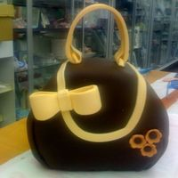 Purse Cake based on cake by Elissa Strauss. Chocolate fondant and gumpaste accents. tfl