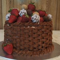 1_1211846680.jpg Chocolate cake filled and iced with chocolate cream. Basketweave and border in chocolate buttercream. The truffles were super-easy and lots...