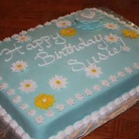 "Daisy Birthday Cake!  I made this cake for my friend's birthday! She wanted ""Tiffany Blue"". I used fondant to cover the cake, and my sister made..."