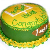 Packers Promotion Cake!  My sister and I made this cake for her husband! He's from Wisconsin, so of course, he's a huge Packer's fan! He got a big...