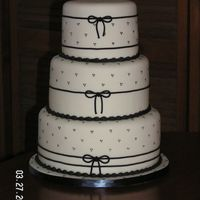 Gamma2.jpg White with black fondant celebration cake
