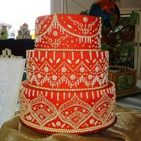 "2009 Eastern Idaho State Fair Entry The theme for the wedding cakes was ""the wedding dress"". I designed a cake after a lehenga gown. 12-10-8 tiers covered in red..."