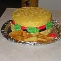 Hamburger And Fries My dh said I couldn't, so I proved him wrong, lol. Just an 8 inch round yellow and chocolate cake. Rice crispies for seeds and icing...