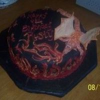 Rusty's Flames Choc MMF w/ gumpaste dragon and choc flames.Thanks for looking. :)