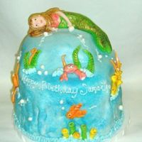 Under Water - Mermaid MMF with BC - my first try at a mermaid - my son said the eyes looked funny... i tend to agree with him. lol This was 6 layers of cake...
