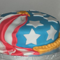 Final Cake - Wilton Course Iv This was the final cake from the Wilton Course IV. Features a Fondant/gum paste drape celebrating the 4th of July.