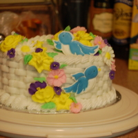 Wilton Course Ii Cake features royal icing flowers, color flow birds and basketweave