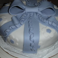 Wilton Course Iii Cake fondant/gum paste bow is the feature of this practice cake.