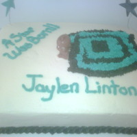 A Star Was Born 1/2 sheet, stars made from fondant attached to floral wiring, baby covered witrh buttercream blanket