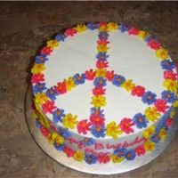 Peace Made this for a friend. She is big into the peace sign. She loved this cake.Not much effort went into it, but I thought it was cute.