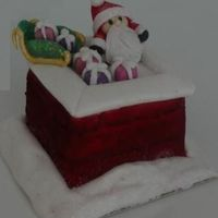 Santa On Chimney Fondant covered cake and figures