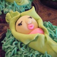 Baby Shower Pea Pod Cupcakes   I made these pea-in-the-pod cupcakes to go with my sister's baby shower cake. I thought they were cute.