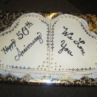 Anniversary Cake  This was the first cake I've made. It was for a couple's 50th anniversary. This cake was huge. It was about 14 x24x6. I didn&#039...