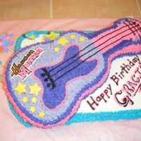 Hannah Montana Guitar Cake   I made this cake for my friend's daughter's birthday.