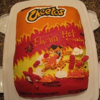 Cheetos Cake  My friends son asked for me to make him a cake for his 18th birthday. He wanted it to be a surprise. His mom and I decided to go with...