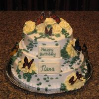 Butterfly Birthday Cake  This was the first time a did a three tiered cake and also the first time making rice paper butterflies. I I know I still need alot of...