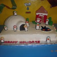 Santas Village Buttercream coverd cake, Fondoant covered igloo and penguines.
