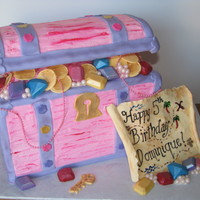 Pink Treasure Chest & Map All edible, except the string of pink pearls. Buttercream with fondant accents. Jewels are chocolate.