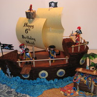 Pirate Ship With Treasure Chest Made this for my son's 6th Birthday. Inspired by many here on CC. Caramel cake (Thx to MacsMom!) filled with Milky Way filling. Iced...