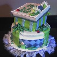 Sweet Pea In A Pod side view fondant covered cake, with fondant peas, babies, and sugar paste box top
