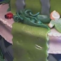 Sweet Pea In A Pod Detail of baby and peas made in fondant. Theme of baby shower was sweet peas.