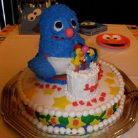 Grover Birthday Cake This is a 3 D cake. Used the Wilton Teddy Bear Cake Pan and sculpted it a bit. Blue Fur piped in Buttercream, and all else covered in...