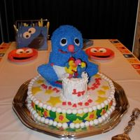 "Grover Wilton Teddy Bear pan. Sliced off the ears and did a bit of trimming. Sat Grover atop a double layer 12"" round, covered in fondant...."