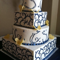 White-Blue--Yellow Wedding Cake White chocolate cake wit hraspberry filling.
