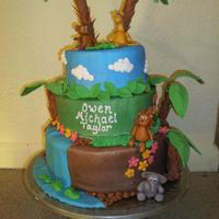 Jungle Shower Cake this was based off quite a few I saw here on CC.. cakes iced in BC w/ fondant detail, pretzel rods used for tree trunks