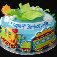 Dinosaur Train Birthday Cake By Charmpastry Based on the PBS Kids show Dinosaur Train, with characters Tiny and the Conductor in fondant. Train is dried out fondant decorated with...