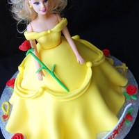 Princess Birthday Cake By Charmpastry Vanilla cake and lemon mousseline built in dome as the Princess' skirt. Plastic doll torso inserted. Fondant details including roses,...