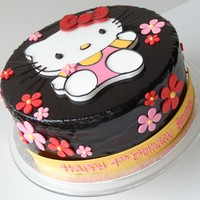 Hello Kitty Birthday Cake By Charmpastry Fondant and royal icing Hello Kitty with daisies. Chocolate cake, chocolate mousse, raspberry mousse, shiny chocolate glaze.